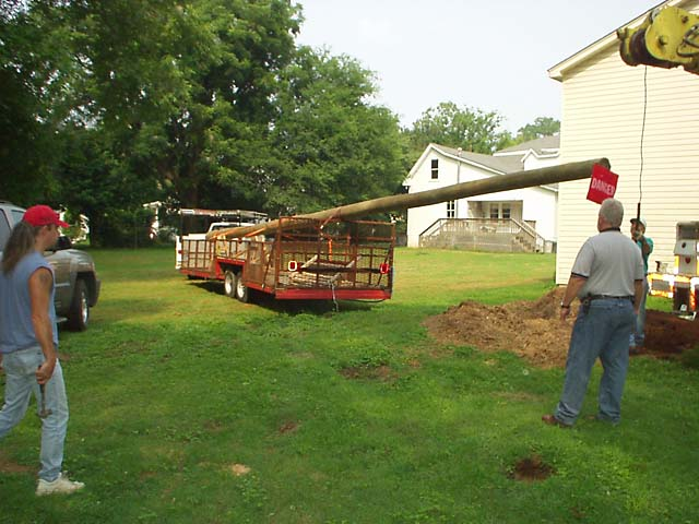 Next, the pole trailer was maneuvered into position.